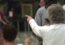 Elderly person pointing in station